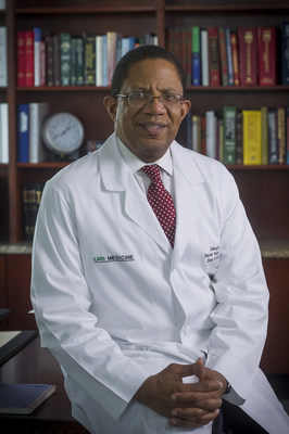 Close-up of Dr. Selwyn Vickers, MD (Dean, School of Medicine) in white medical coat, 2013.