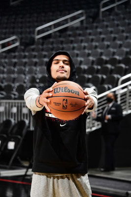 Wilson Advisory Staff member and Atlanta Hawks point guard, Trae Young, holds the new official game ball of the NBA.