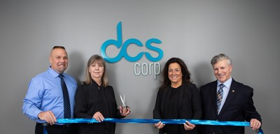 DCS's Rick Whitt, Gail Shepard, Marianne Curren, and Dale McDonough cut the ribbon to open the new Bridge Street office location.